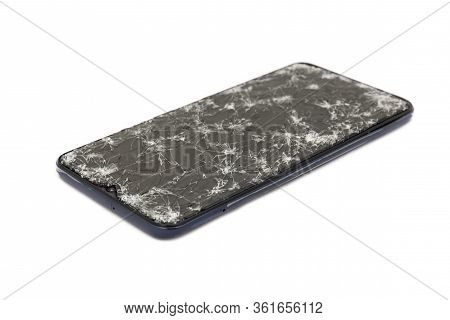 Closeup Of Modern Mobile Smart Phone With Broken, Cracked Screen Isolated On White Background. Selec