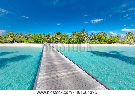 Maldives Island, Luxury Resort Hotel And Wooden Pier, Jetty. Beautiful Sky And Clouds And Beach Back