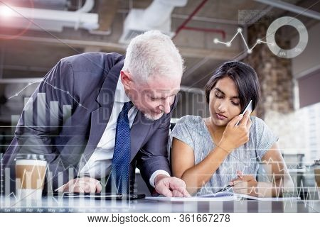 Focused Business Leader Supervising Managers Work With Virtual Analytical Charts. Young Woman Speaki