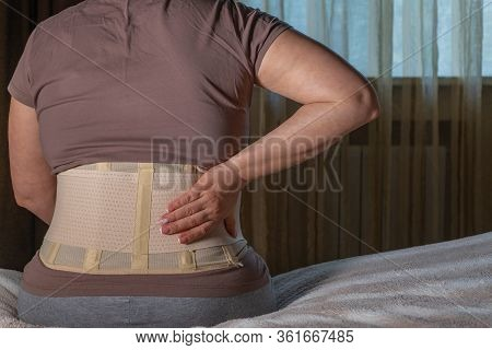 Image Of A Girl In A Lumbosacral Corset Or Orthopedic Corset For A Posture Corrector