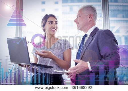 Two Experts Sharing Experience After Business Seminar. Young Woman With Laptop And Mature Man In Sui