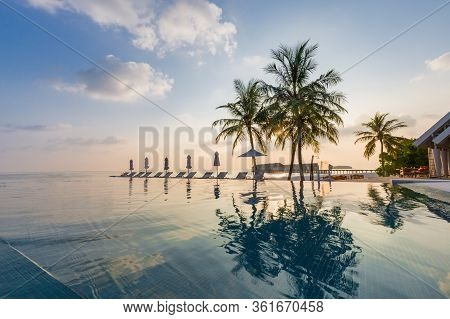 Beautiful Poolside And Sunset Sky. Luxurious Tropical Beach Landscape, Deck Chairs And Loungers And