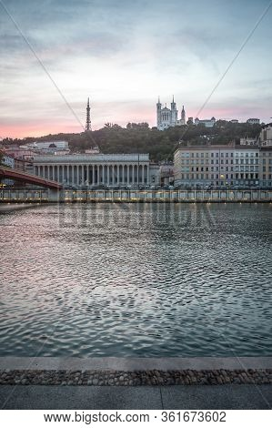 Panorama Of Riverbank Of Saone River In Lyon, At Dusk, With Colline And Basilique De Fourviere Churc