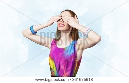 Redhead Beautiful Woman With Hands Covering Eyes. Elegant Lady Wears Bright Dress And Bracelets. Hap