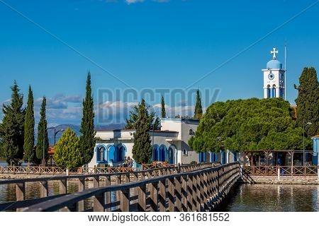 Porto Lagos, Greece - November 29, 2019: Tourists Enjoy The Beautiful Monastery Of St. Nicholas Buil