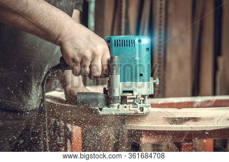 Wood Milling With Electric Cutter In Joinery. Color Toning. Copy Space