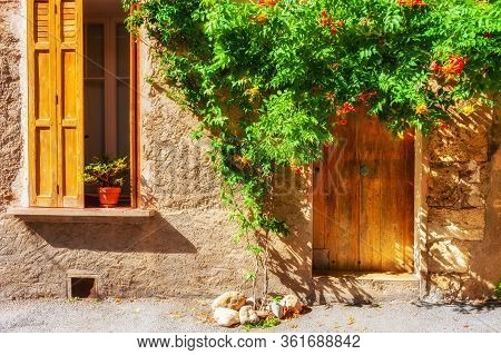 Old Architecture In Valensole, Provence, France. Window With Wooden Shutters And Door With Green Dec