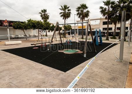 Torrevieja, Valenciana, Spain - Empty Childrens Playgound Due To Corvid-19 Virus Outbreak And Self I