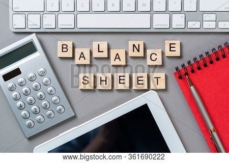 Balance Sheet Concept With Letters On Wooden Cubes. Still Life Of Office Workplace With Supplies. Fl