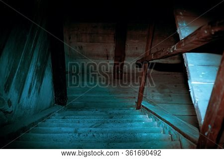 Mystical Horror Scary Garret Background To Halloween. Old Antique Dirty Wooden Staircase In Darkness