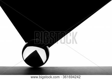 A Crystal Ball With Geometric Black And White Shape. Glass Ball On Black And White Background.