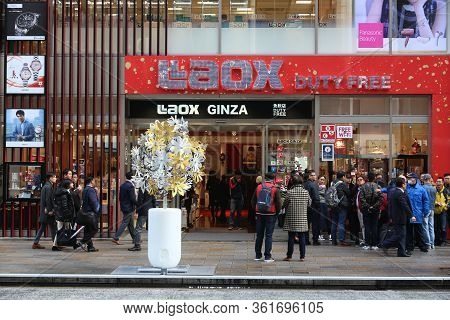 Tokyo, Japan - December 1, 2016: People Walk By Laox Duty Free Store At Ginza District Of Tokyo, Jap
