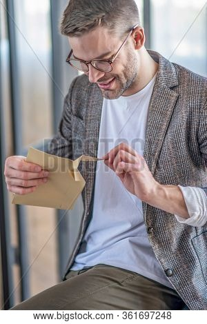 Stylish Fair-haired Man In Eyeglasses Looking Anticipated