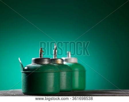 plastic green color oil lamp on green background