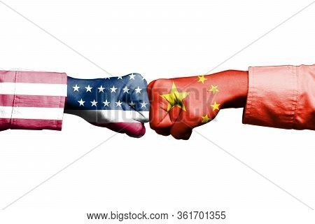 Usa And China Flag Print Screen On Fist Hand On White Background. Its Is Symbol For Tariff Trade War