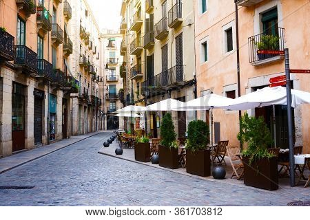 Girona, Spain - January 23, 2019: Empty Street In Old Town With Cafe. Girona, Catalonia, Spain. Non-