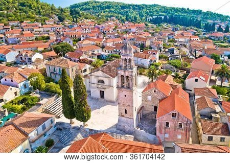 Korcula Island. Town Of Vela Luka Church Tower And Rooftops Aerial View, Archipelago Of Southern Dal
