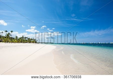 A Wave On The White Sand Of A Beautiful Beach On A Tropical Island On The Shore Of The Atlantic Ocea