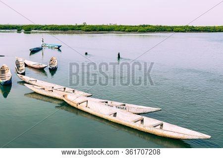 Joal-fadiouth, Senegal - November15, 2019: Fishers And Small Long Boats. Fadiauth Island. Senegal. W