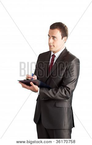 businessman writing in clipboard