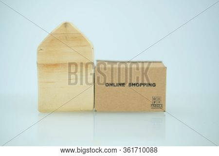Miniature Brown Box And Miniature Home. Promote Stay At Home And Shopping Online. Coronavirus, Covid