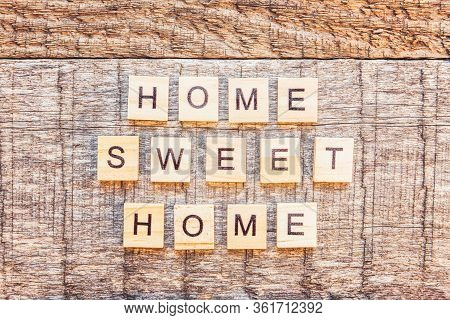 Stay Home Stay Safe. Inscription Home Sweet Home Letters Word On Wooden Background. Social Distancin