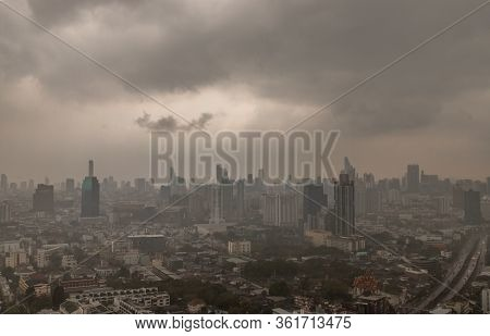 Bangkok, Thailand - 13 Apr, 2019 : Dark Clouds Before A Rain Are Falling In The City. A Large Rainst