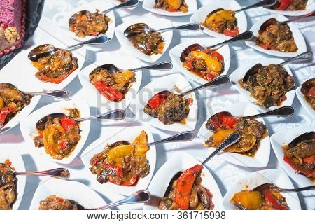 Small Plates With Appetizer, Salad For Guests Of The Event And Celebration. Catering Guest Meals Dur