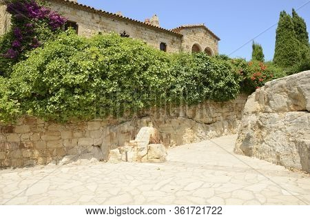 Plants On Stone Wall Along Footpath In The Medieval Village Of Pals, Located In The Middle Of The Em