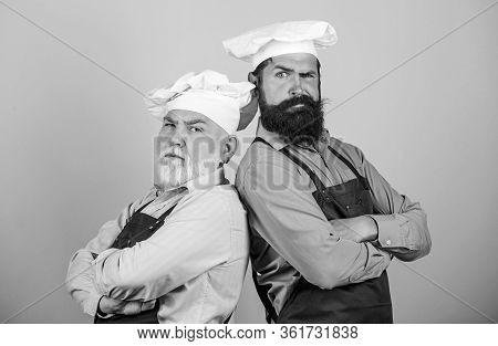 Culinary Show. Restaurant Staff. Culinary Battle. Mature Bearded Men Professional Restaurant Cooks C
