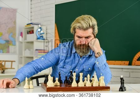 Thinking About Next Step. Chess Is Gymnasium Of Mind. Chess Lesson. Strategy Concept. School Teacher