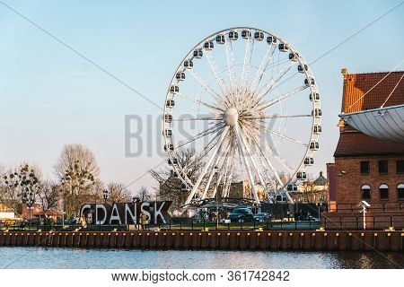 Gdansk, Poland, February 8, 2020. Gdansk Giant 3d Letters Sign With A Ferris Wheel In The Background