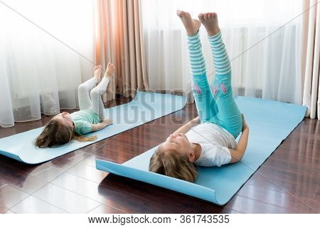 Little Girls Make Home Workout In Flat. Baby Yoga,fitness Training. Physical Morning Exercises On Bl