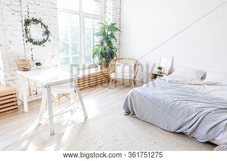 Stylish Loft Bedroom Interior. Spacious Design Apartment With Light Walls Large Windows Big Bed. Cle