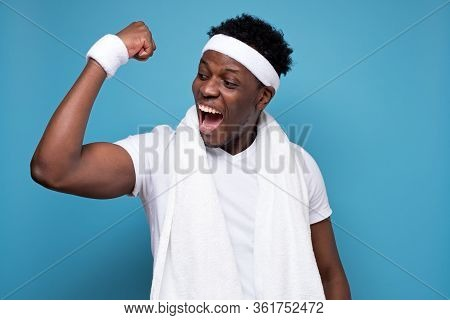Happy Young African American Man Triumphant Celebrating His Results And Success At Sport.