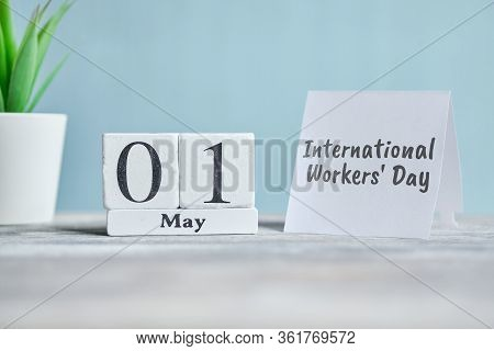 Holiday International Workers Day - 1 First May Month Calendar Concept On Wooden Blocks. Close Up.