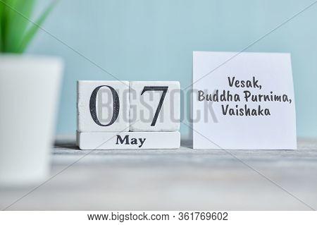 Holiday Vesak, Buddha Purnima, Vaishaka - 7 Seventh May Month Calendar Concept On Wooden Blocks. Clo