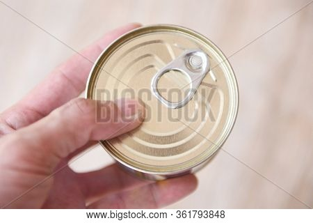Canned Food Metal Cans In Hand / Canned Goods Non Perishable Food Storage Goods In Kitchen Home Or F