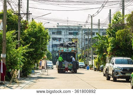 Nonthaburi, Thailand- April 17, 2020 : Local Garbage Collector Is  Collecting Garbage Into The Garba