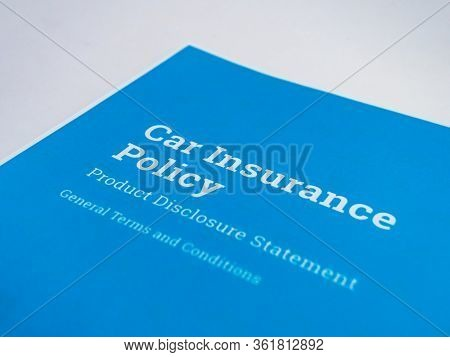 Simplistic Shot Of A Car Insurance Policy Paper With General Terms And Conditions