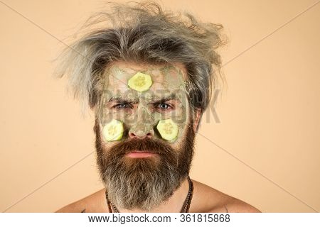 Close-up Portrait Of Morning Man Applying Facial Mask. Spa Concept. Man With Facial Mask In Beauty S