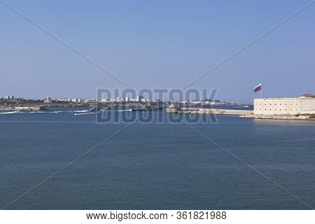 Sevastopol, Crimea, Russia - July 28, 2019: Small Missile Ship Vyshny Volochek, Accompanied By Milit