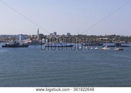 Sevastopol, Crimea, Russia - July 28, 2019: Sea Minesweeper Zheleznyakov And Turbinist Pass Along Th