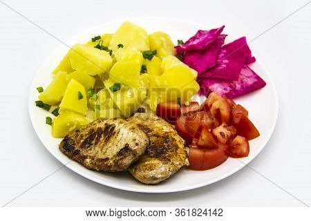 Mini Steaks Of Meat With Potatoes, Tomatoes And Pickled Cabbage Name Pelyustka On White Plate. Healt
