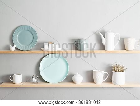 Shelf With Dishes. Kitchenware On Wooden Shelves. Various Food Ingredients And Utensils On Kitchen S