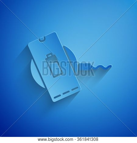 Paper Cut Smartphone Charging On Wireless Charger Icon Isolated On Blue Background. Charging Battery