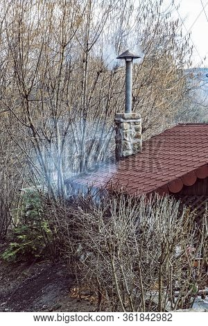 Preparing Food In The Garden House, Stiavnica Mountains, Slovak Republic. Smokestack Scene.