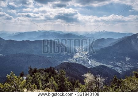 Big Fatra Mountains And Stankovany Village From Sip Peak, Slovak Republic. Seasonal Natural Scene. T