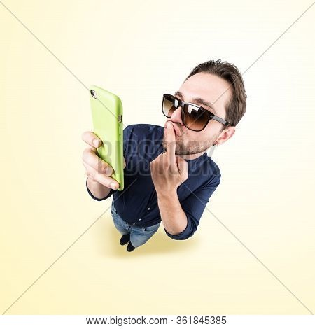 Latin Lover Make A Funny Face, And Take A Self Portrait With His Smart Phone