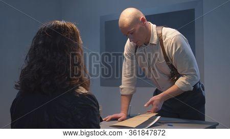 Interrogation Of The Suspect. Serious Cop. Sliding